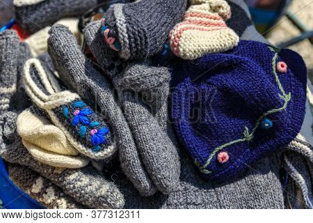 Hand Knitted Wool Socks, Slipers And Hats At An Outdoor Farmers Market In Old Town Kotor, Montenegro