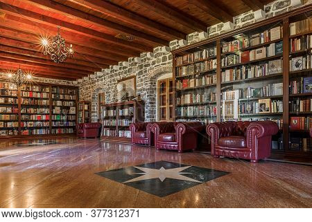 Budva, Montenegro - May 30, 2019: Wood And Brick Interior Of The Library Inside The 15th Century Cit