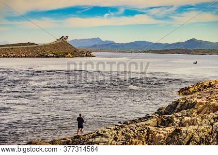 Atlantic Road, Norway - July 11, 2018: Angler With Fishing Rod On Atlantic Road In Norway Europe. No