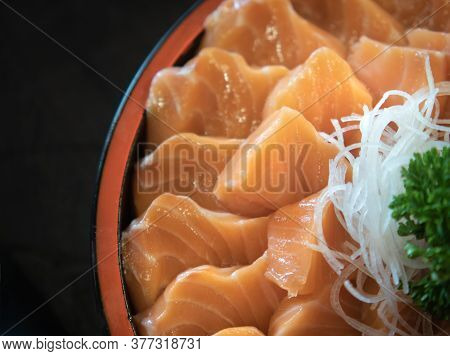Fresh Sashimi Salmon Fillet In A Bowl. Japanese Dish With Vegetables, Selective Focus.