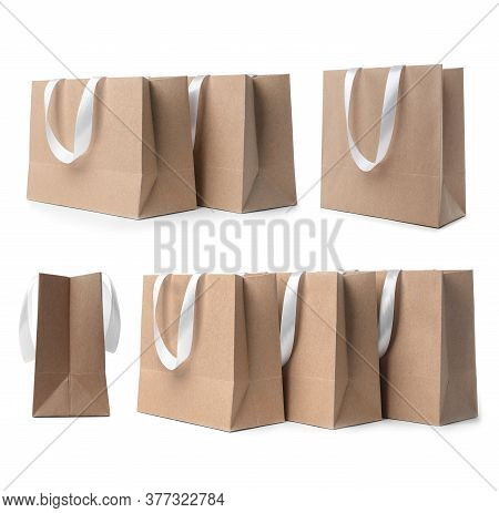Set With Kraft Paper Shopping Bags On White Background
