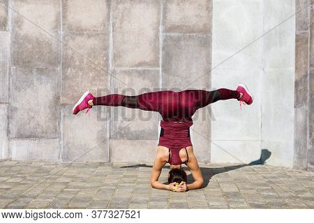 The Girl Performs An Exercise On The Elbows With A Transverse Twine. Healthy Lifestyle Concept
