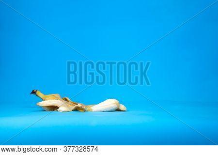 Image Of Squashed Peeled Fresh Banana On Blue Background
