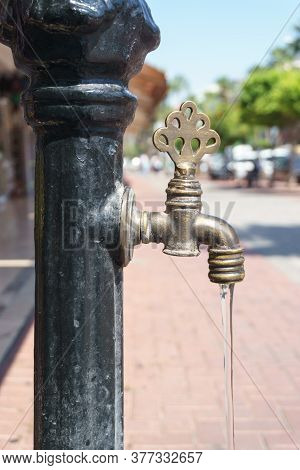 A Tap With Drinking Water On The Street. Water Flows From The Tap