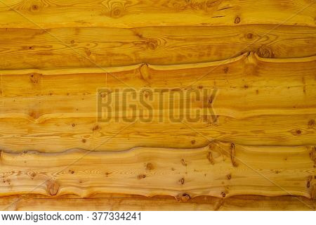 The Wall Is Made Of Boards With Knots, The Boards Are Covered With Light Varnish.