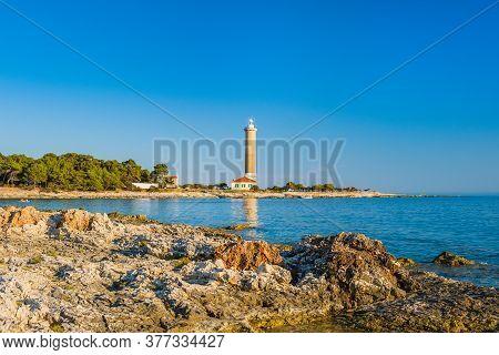 Lighthouse Of Veli Rat On The Island Of Dugi Otok, Croatia, Beautiful Adriatic Seascape And Rocks In