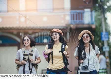 Asian Woman Group Backpacker Travel On Street Together, Friendship Traveller Backpack Travel For New
