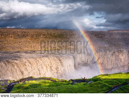 Dettifoss Waterfall And Rainbow, Iceland. Famous Place In Iceland. A Mountain Valley And Clouds Afte