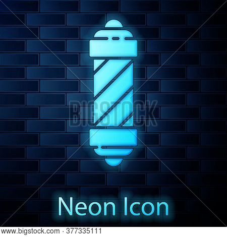 Glowing Neon Classic Barber Shop Pole Icon Isolated On Brick Wall Background. Barbershop Pole Symbol