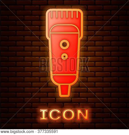 Glowing Neon Electrical Hair Clipper Or Shaver Icon Isolated On Brick Wall Background. Barbershop Sy