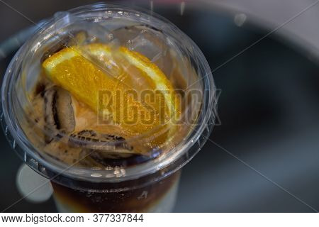 Iced Coffee With Orange Or Yuzu Espresso Tonic - Close-up A Plastic Glass Of Espresso Mixed With Ton