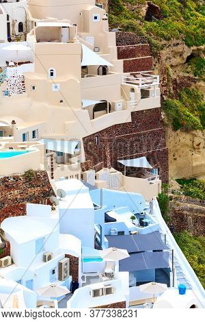 Oia, Santorini Traditional Village In Cyclades Island With Colorful Houses, Greece