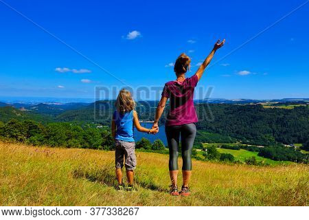 family tourist in France, lac Chambon, Auvergne in France