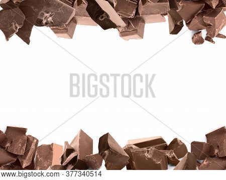 Set With Delicious Chocolate Chunks On White Background. Space For Design