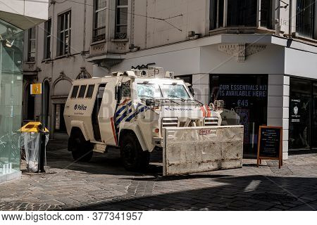 Ghent, Flanders, Belgium - July 15 2018 : White Armored Riot Truck With Front Clearing Blade Of Belg