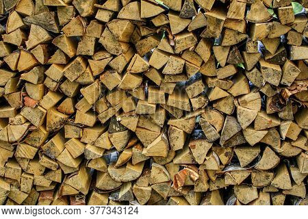 Wall Firewood, Background Of Dry Chopped Firewood Logs In A Pile