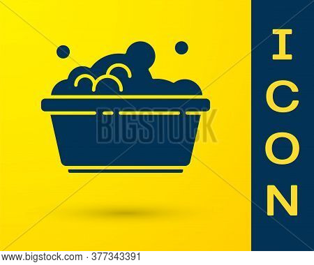 Blue Plastic Basin With Soap Suds Icon Isolated On Yellow Background. Bowl With Water. Washing Cloth