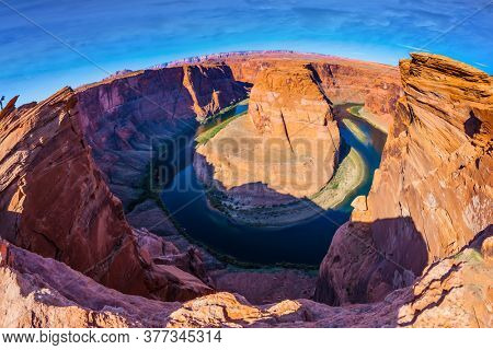 USA, Arizona, Glen Canyon Recreation Area. Horseshoe Bend is a beautiful meander of the Colorado River. Deep canyon of red sandstone. Concept of active and photo tourism