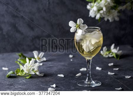 Apple Cider Or Calvados With Ice Cubes In Wine Glass. Refreshing Cool Summer Drink, Lemonade Or Ice