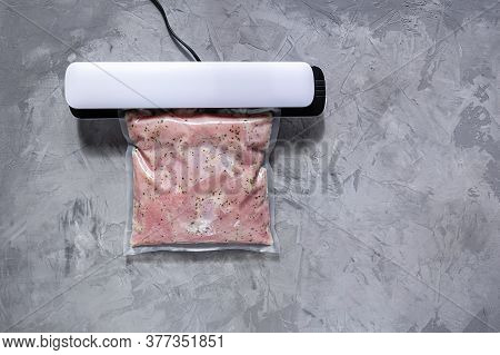 Vacuum Packing Of Meat For Long-term Storage. Turkey Fillet In A Vacuum Bag.