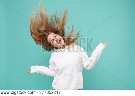 Cheerful Young Woman Girl In Casual White Hoodie Posing Isolated On Blue Turquoise Background Studio