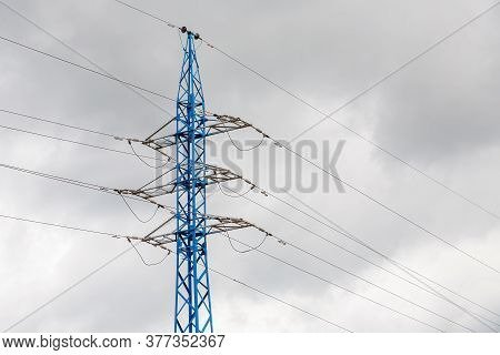 Electricity Pylon Silhouetted Against Cloud Sky Background. High Voltage Tower.