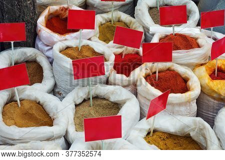 Sale Of Indian In Open Air Market. Selling For Weight From Full Bags Empty Nameplates And Prices. Se