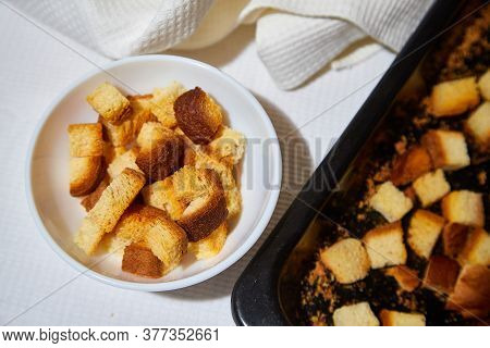 Square Toasted Pieces Of Homemade Delicious Rusk, Hardtack, Dryasdust, Zwieback On A White Plate And