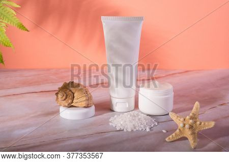 Sea Salt Skin Care Cosmetics Bottle And Jar With Cream On A Marble Background. Dead Sea Natural Crea