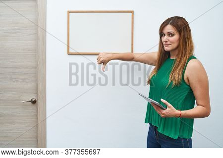 Young Teacher Teaching With A White Board And A Tablet. Concept Of Study, Classes And New Course.