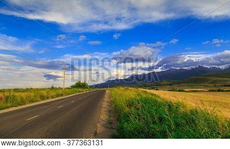 Beautiful Summer Landscape. Mountain Country Road Among Green Hills. Lush Green Hills, High Mountain