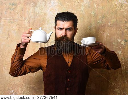 Waiter With Tea Cup And Pot. Barman With Serious Face