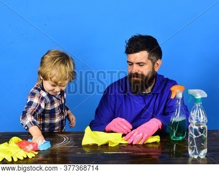 Guy With Beard And Mustache In Gloves Near Cleaning Props