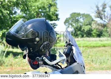 Motorcycle Helmet. Helmet For Moto On The Background Of Nature.