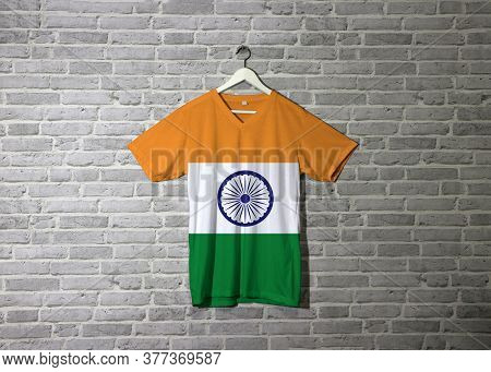 India Flag On Shirt And Hanging On The Wall With Brick Pattern India Saffron Orange White And Green
