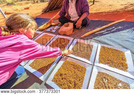 Kings Creek, Australia - Aug 21, 2019: Tourists Experiencing The Culture Of Australian Aboriginal Pe