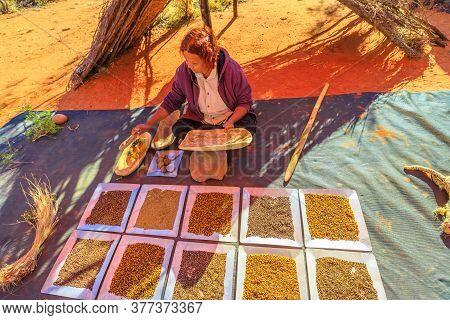 Kings Creek, Northern Territory, Australia - Aug 21, 2019: Australian Aboriginal Woman Showing The T