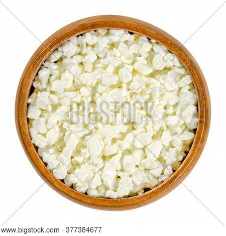 Cottage Cheese Curd Grains In Wooden Bowl. Igredient To Make A Fresh Cheese Curd Product Also Known