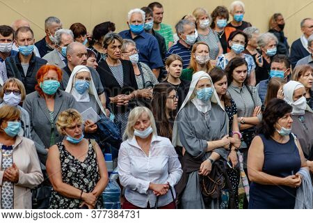 Uzhgorod, Ukraine - July 20, 2020: Nuns In Protective Masks And Parishioners Pray During The Farewel