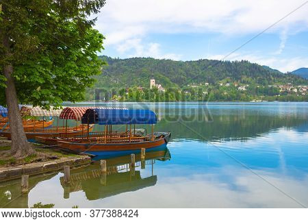 Bled/slovenia - May 01, 2018: Traditional Pletna Boats Waiting For Tourists On Lake Bled, Famous Att