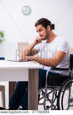 Young disabled man working from house