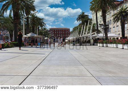Split Croatia July 2019 Riva Promenade Near The Sea In The Old Town Of Split, Tourist Walking By On