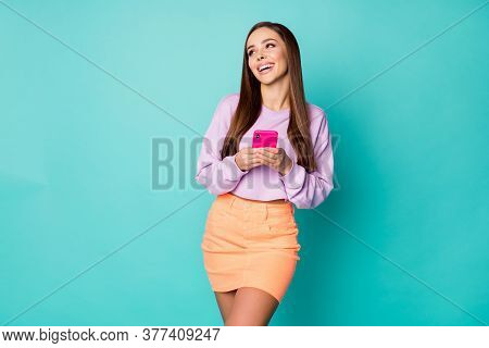 Photo Of Cheerful Lady Hold Telephone Write Message E-mail Friends Laughing Out Loud Cool Joke Wear
