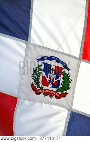 Close up photo shot of wavy Dominican Republic flag.