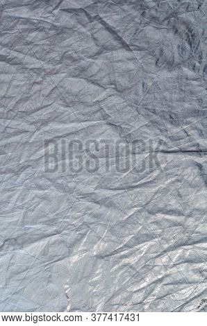Texture Silvery Fabric Reflector, Simple Crumpled Background.
