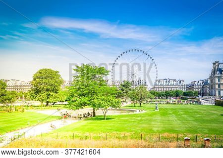 Summer Holidays In Paris. Tuileries Gardens With Ferry Wheel, Paris France With Sunshine