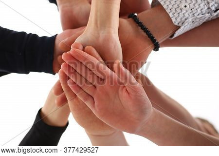 Group Of Young Specialists Holding Hands Together While Participating In Teambuilding Conference