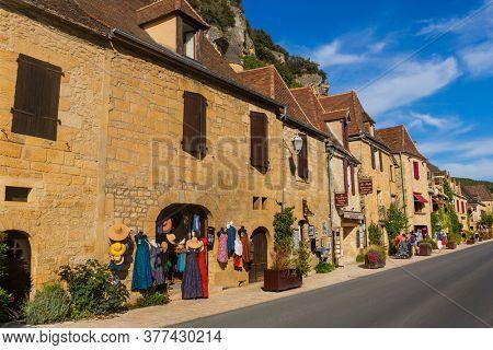 La Roque-Gageac, Dordogne, France - August 13, 2019: People visiting La Roque-Gageac scenic village on the Dordogne river, France