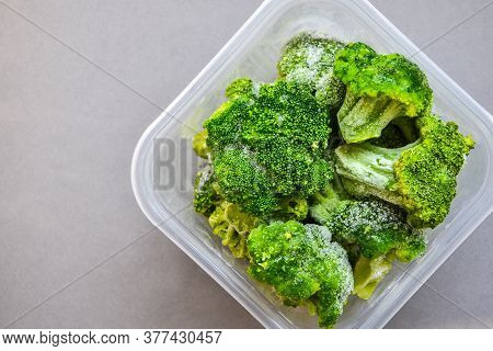 Broccoli In A Plastic Container For Long-term Storage. Deep Freezing Of Vegetables. Frozen Food Vege