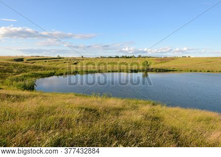 A Small Reservoir In A Ravine On A Summer Evening